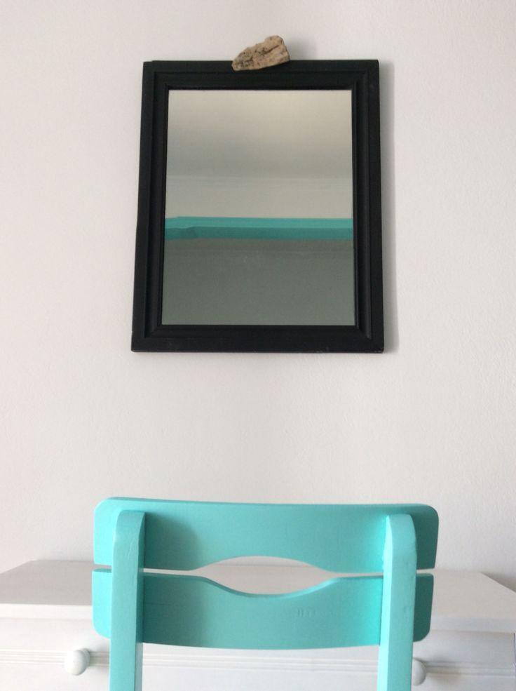 mirror framed by black board paint