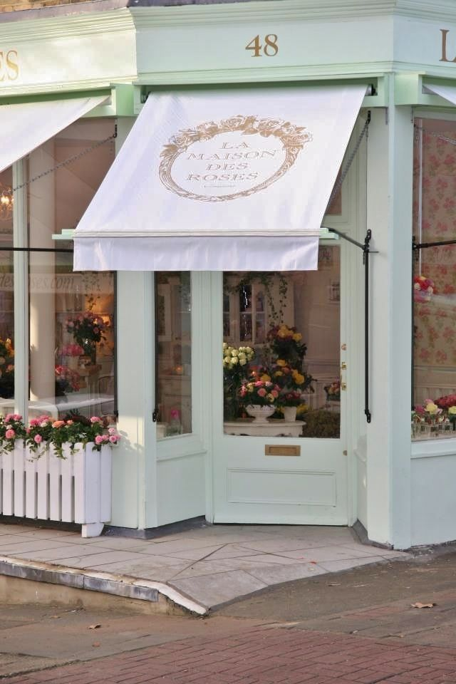 I would love my flower shop to look like this one day! Charming! love the windows, awning, moldings, and angle of door