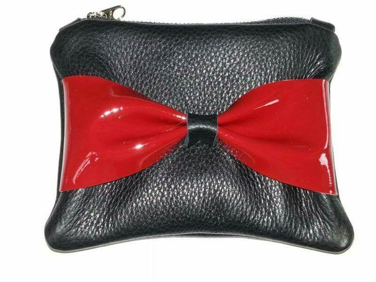 Black leather clutch with red patent bow