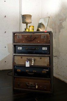 A chest of drawers made of old suitcases