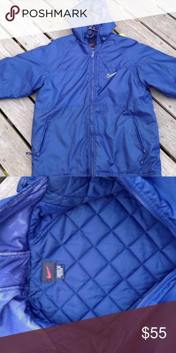 Nike winter coat. Nike navy blue winter coat in great shape! True to size. Not form fitting. Zippered pockets. Nike Jackets & Coats
