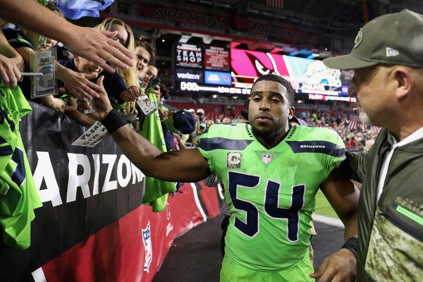 Bobby Wagner Photos - Middle linebacker Bobby Wagner #54 of the Seattle Seahawks high fives fans following the NFL game against the Arizona Cardinals at the University of Phoenix Stadium on November 9, 2017 in Glendale, Arizona.  The Seahawks defeated the Cardinals 22-16. - Seattle Seahawks v Arizona Cardinals