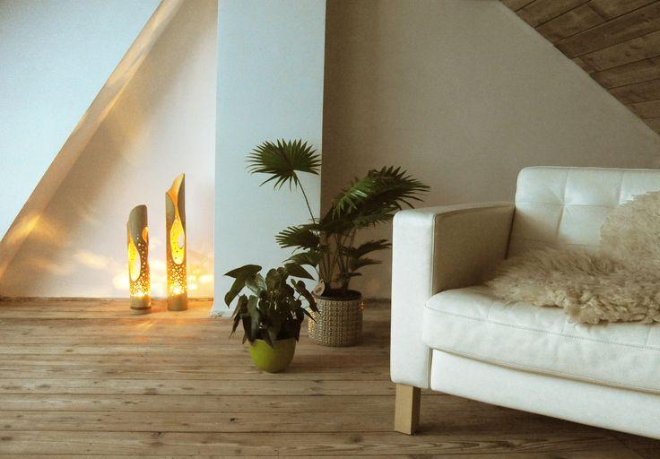 Kom helemaal tot rust in een woonkamer met natuurlijke tinten en bamboe accessoires.