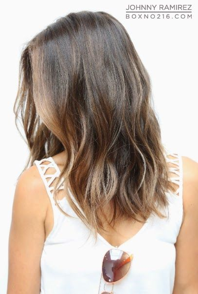 medium brown color with an auburn tint + barely-there sunkissed pieces throughout her ends. {Box No. 216}