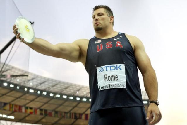 Beginner's Track and Field: Learning the Discus Throw: The discus throw begins with the proper grip. Jarred Rome places his middle and index fingers together. Others hold the discus with their fingers spread out.