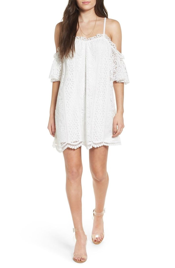 The perfect dress to style for spring break, bridal showers or a fancy brunch with the girls, this sweet lace shift is fashioned with shoulder-baring cutouts and a pretty scalloped hem.