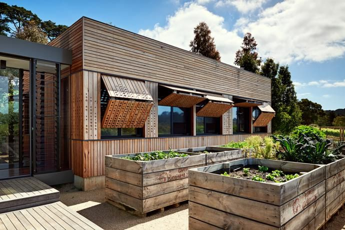 Wooden home with interesting exterior blinds. https://www.quick-garden.co.uk/residential-log-cabins.html