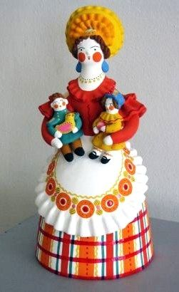 Russian traditional Dymkovo toy is a painted clay toy from the village of Dymkovo. A nanny holding two kids. #folk #art