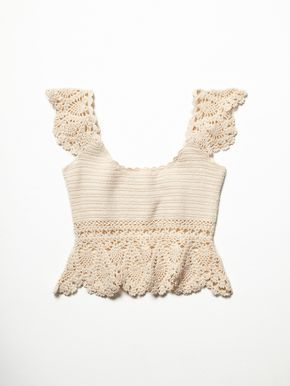 Crochet Babe Top | Cotton crochet crop top featuring scalloped trim along the neckline and cap sleeves. Uneven hem with a wider sheer knit.