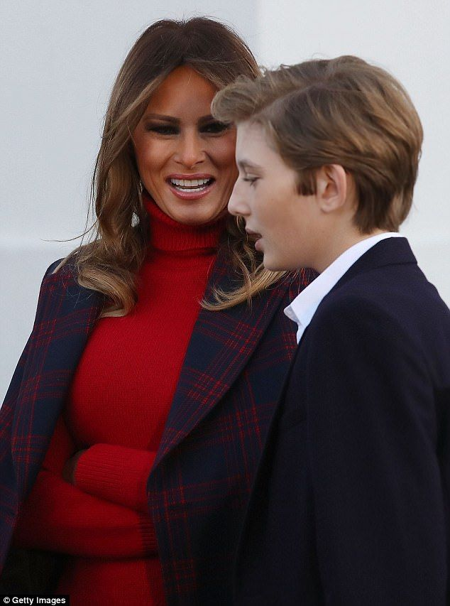 First lady Melania Trump (left) smiles at her son Barron Trump (right) as they take a look at the official White House Christmas tree