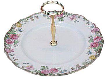 Round, single-tiered handled cake plate. Non-original item.