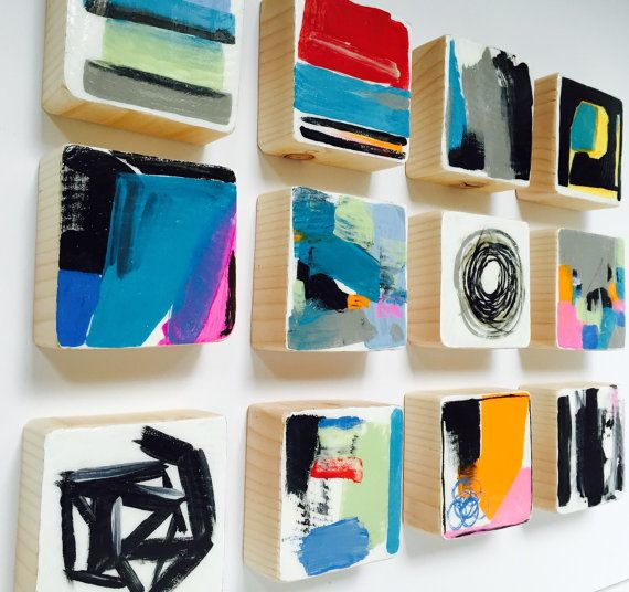 These Set of 12 Modern Scandinavian modern painted wall wood cube sculptures are a perfect art statement for your home, office, corporate offices, commercial lobby, hotel, hospital or any public space. Each piece of wood is hand sawed and hand sanded . Then we apply the acrylic paint by hand. Each painting is then sealed with a top coat to preserve the color and the wood. In the end, the wall sculpture painting is colorful, modern, vibrant, shiny, and unique. Hand-crafted by d.elizabeth…