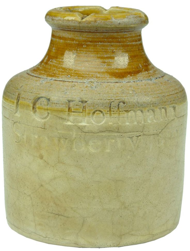 Auction 27 Preview | 565  | Hoffmann Strawberry Jam Stoneware Jar  I C Hoffmann, Strawberry Jam. 115 mm. Odd colouration to Good, glaze blowout to upper lip, stained, neck glaze, this and many of the other marks are from making. heavy crazing, discoloured, hairlines (6.5)   sold $10