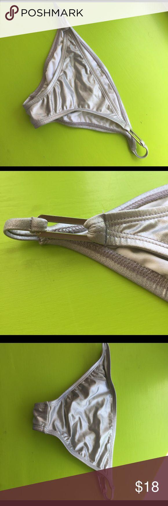 Silver bikini bottoms Silver Bebe sport bikini bottoms. Size small. Silver metal rectangles on both sides of hip. Very cute. Never worn because too small for me bebe Swim Bikinis