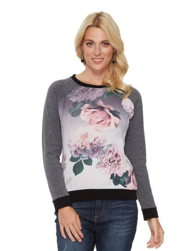 With a floral print matte satin front panel, this long-sleeve sweatshirt has a contrast cuff and neckband.