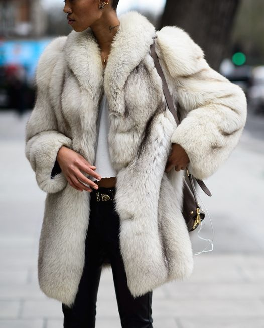 White faux fur coat and black jeans combination. Great winter wardrobe inspiration.