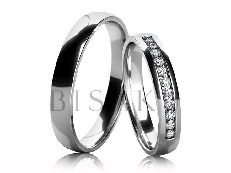 4693 Snubní prsteny z bílého zlata v lesklém provedení (vysoký lesk). Vzhledem k jemnému a elegantnímu provedení dámského prstenu, lze tento model snadno kombinovat se zásnubním prstenem. Dámský prsten je přibližně do poloviny prstenu zdoben kameny. #bisaku #wedding #rings #engagement #svatba #snubni  #prsteny