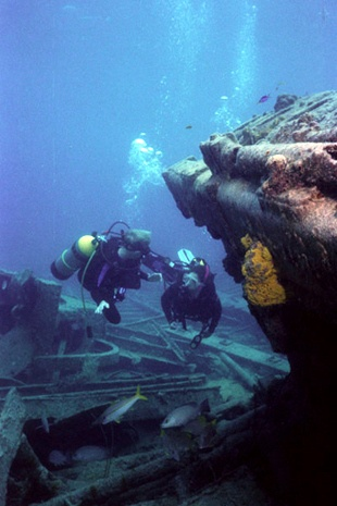Diving the wreck of the Oro Verde off Grand Cayman. Met Harvey, a 200 lb Grouper that weighs 200 lbs because divers feed him.