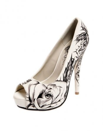 Iron Fist Wedding Shoes (a favourite gothic punk shoes repin of VIP Fashion Australia )  -Dunno if these are actually IF or not but I wish I found these for my wedding...although mine are similar, I like the black on white better.