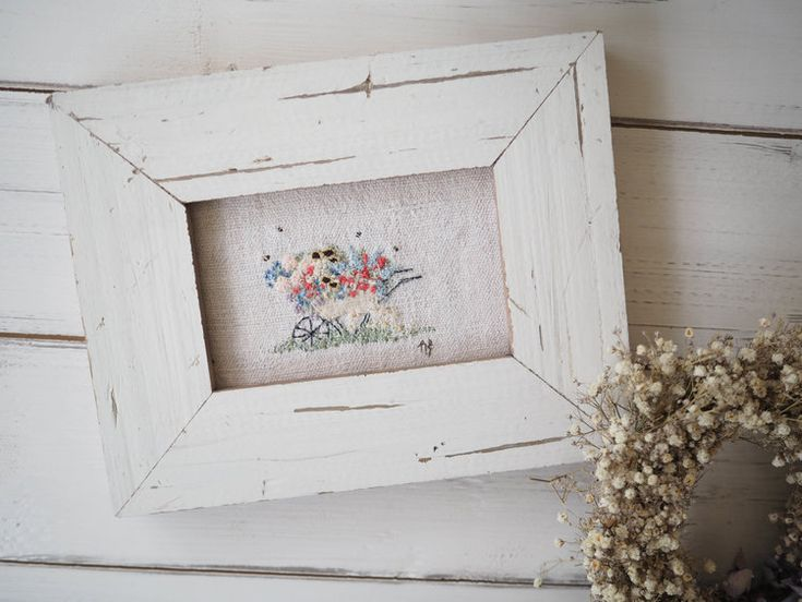 hand embroidered wheelbarrow picture in chippy frame with flowers