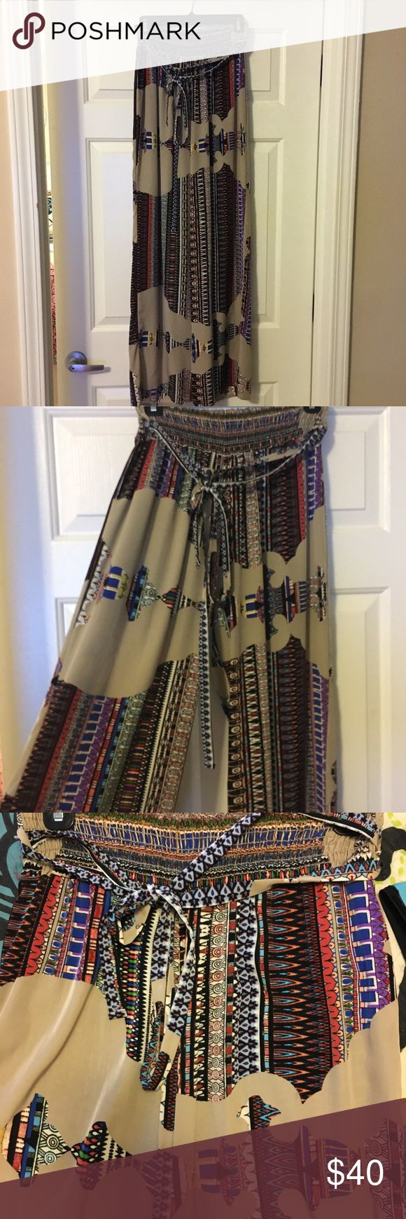 """Aztec pants - Size Medium Cute fun and free flowing Aztec printed pants. Perfectly unique for the girl that wants to stand out. Dress them up or dress them down. Only worn twice. Size Medium. I am 5'9"""" and they are long enough for me. Can be worn with heels or flats. Pants"""
