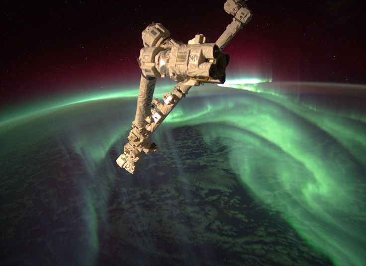 """""""20 July 2012. It looks like the opening shot of a sci fi film with a spacecraft looming over an alien world - but in fact, it's our own Earth, and the mysterious spaceship is one of the robot arms of the Space Station. The shot was captured by the current Expedition 32 team on board the Space Station, and shows the 'Southern Lights' erupting over our planet's south pole."""": Southern Lights, Space Station, Trav'Lin Lights, International Spaces, Aurora Australi, Northern Lights, Aurora Borealis, Spaces Stations, Photo"""