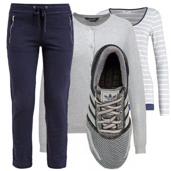 Ecco un look estremamente comodo e miimale. Pantalone blu, maglia a righe grigio e blu, cardigan grigio e scarpette compongono un look perfetto per una giornata in cui vi sentite sportive.