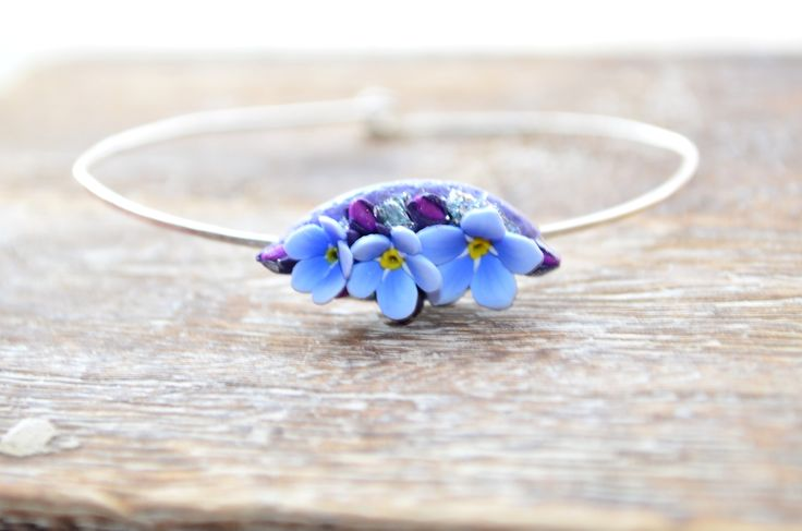 Delicate sterling silver bangle bracelet with realistic blue forget-me-not flowers handsculpted from polymer clay. This bracelet is simple, yet feminine and is suitable not only for everyday wear, but also for a special ocasion. innette.etsy.com