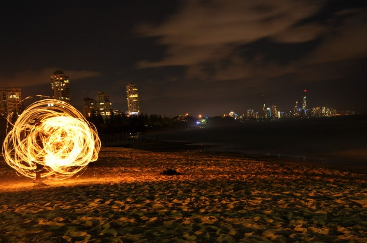 There's nothing like watching the fire twirlers at Burleigh Heads on a Sunday night, listening to the drums and looking at the lights of Surfers Paradise. Ben Stuart, Townsville, #Queensland #summer #Burleigh