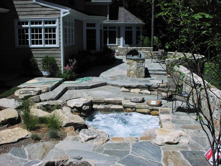 Traditional Hot Tub with Outdoor kitchen, Pathway, exterior stone floors