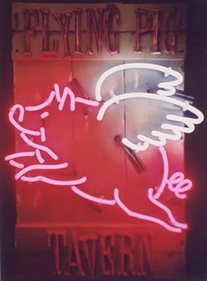 Vintage neon sign- Flying Pig Tavern.  Perhaps inspiration for our When Pigs Fly necklace.