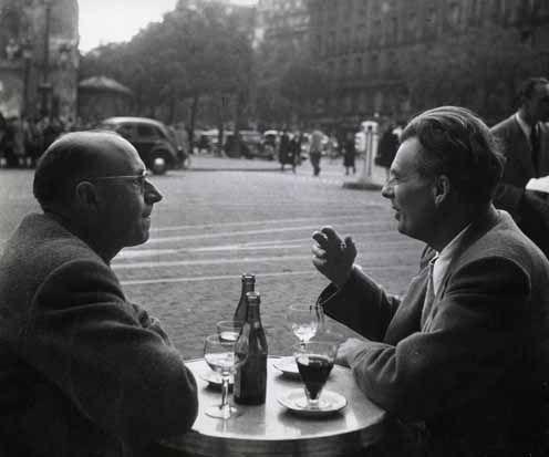 Robert Doisneau - Pierre Neveu and Author Aldous Huxley, on the Terrace of Flore Café, Saint-Germain-des-Prés, Paris, Drinking Wine 1945