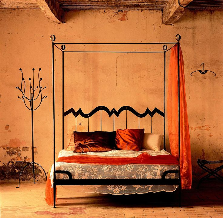 amazing tuscan style black wrought iron canopy bed feature satin red orange pillows and beige sheer accented bed linen sheets plus satin orange canopy - Orange Canopy Interior