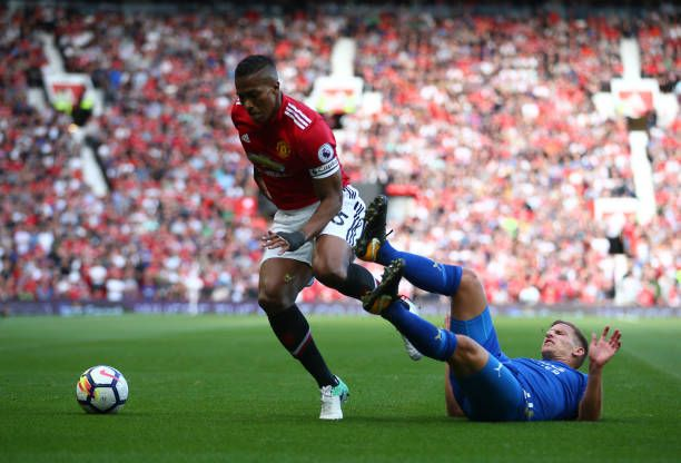 Manchester United's Antonio Valencia and Leicester City's Marc Albrighton battle for the ball during the Premier League match at Old Trafford...