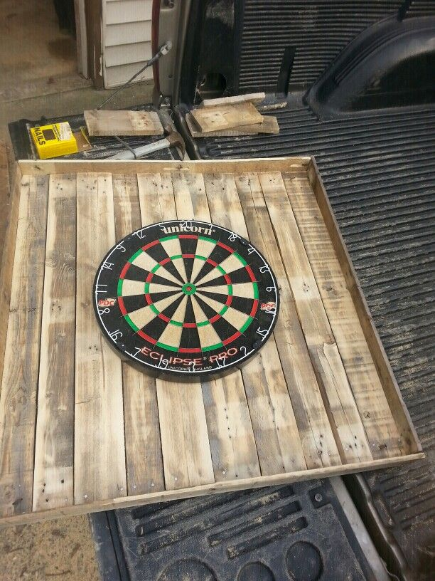 Made from some old pallets and a new dart board and for just under  $60 a nice dart board for the man cave or game room.. #mancave #darts #gameroom