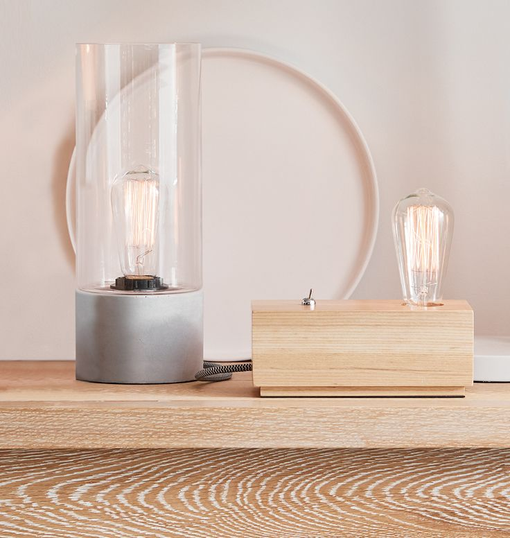 The Beacon Lighting Stoic 1 light table lamp with clear glass and concrete base with herringbone flex.