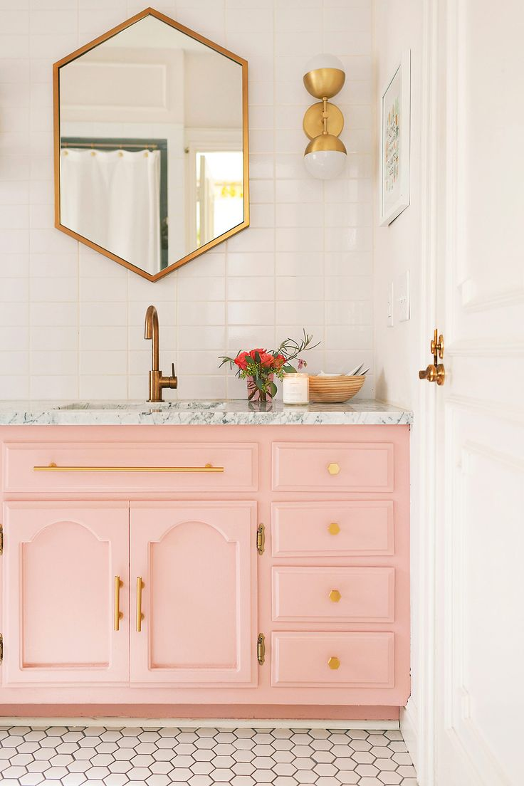Pretty Pink And Gold Bathroom With Pink Vanity, Marble Counter, Gold  Faucets And Hardware And Vintage Vibe