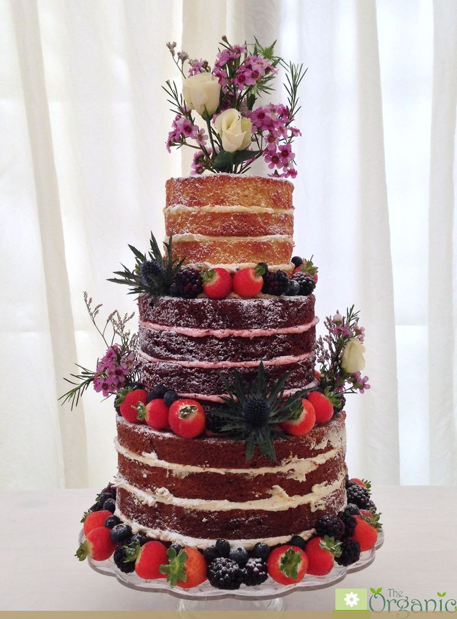 The #Organic #Wedding #Cake company. How amazing does this cake look?!  Gluten free naked wedding cake Zingy lemon sponge and passionfruit curd buttercream, Raspberry red velvet cake and raspberry buttercream, Spiced carrot and pistachio cake with zesty orange buttercream