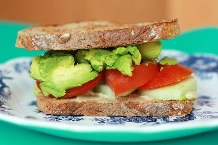 On a day when you're eating #bread, try a  toasted #tomato, #avocado, cucumber & #hummus #sandwich.