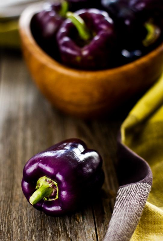 Want color but not a lot of pepper flavor? Grow purple beauty peppers. I found this photo with a recipe for stuffed peppers. Purple beauties are much smaller than most bell peppers. Think about stuffing mushroom caps to get an idea of how many you would need depending if they were a main dish or side dish. I think as a side dish you could use all kinds ingredients in stuffing for eye appeal.