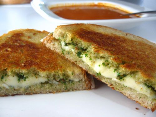 Pesto Grilled Cheese - I would use my homemade bread, mozzarella cheese and coconut oil in place of butter - and I have my own basil! Time to make the pesto!