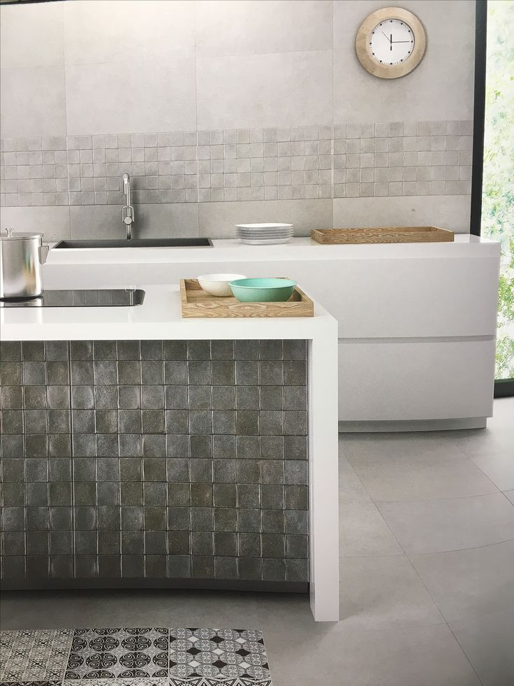 Our Greta G and Lubeck series installed. 31 x 60 and 60x60 kitchen/bathroom tiles