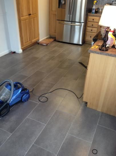 Vinyl Tile Flooring we used a vinyl grout made specifically for vinyl tiles using a grout float we pushed grout into the grout lines then carefully scraped extra grout from Coastal Grey Resilient Vinyl Tile Flooring 30 Sq Ft Case