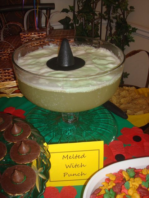 melted witch punch! we could put the witch hat on top of the drink dispenser.