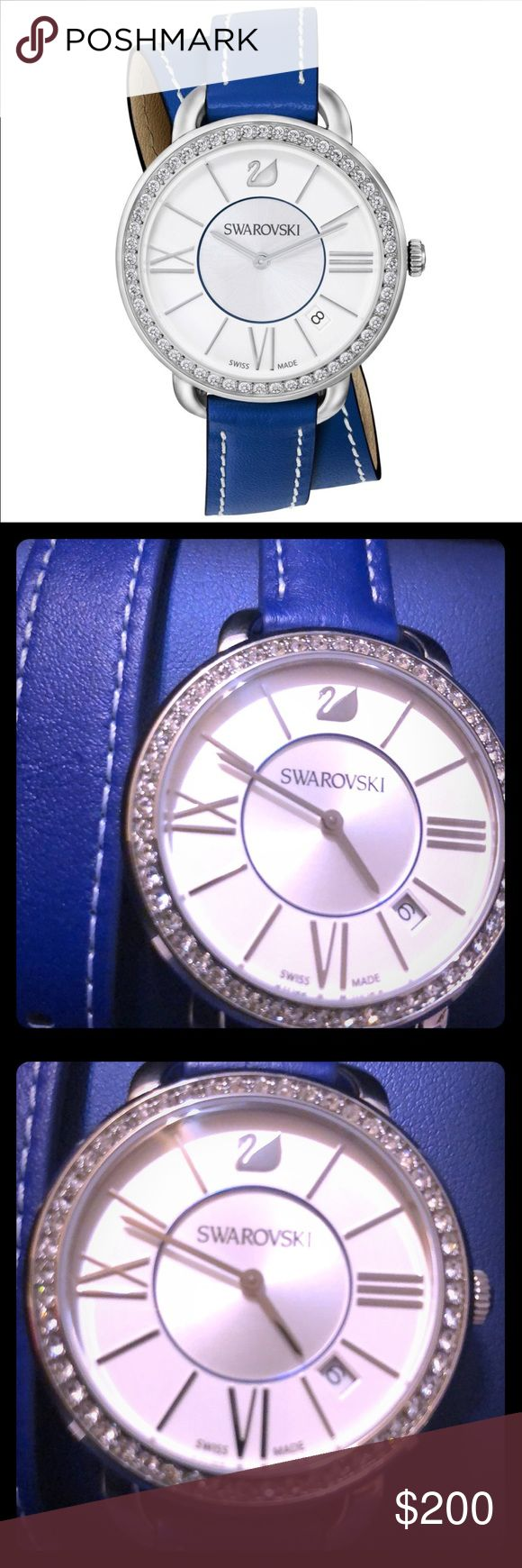 Swarovski Aila Double Wrap Leather fine watch Featuring a double blue strap this feminine watch will add a trendy touch of sparkle and color to your wrist. Case : stainless steel with 52 clear crystals. Size 37mm. Dial : white silver sunray with a matt white silver outer bezel silver plated index markers and Roman numerals at 3 6 and 9 oclock.  Strap : blue calfskin leather double tour with white stitching.  Water resistant.  Movement : Swiss Quartz. Brand new in box never worn $344.USD…