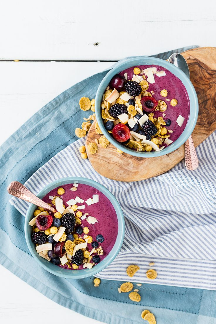 A sweet blend of strawberries and blueberries gives this smoothie bowl a rich purple hue. Coconut water, dairy-free vanilla yogurt, and hemp seeds add a touch of nutty sweetness to make this smoothie bowl a satisfying base for fresh berries and cherries, toasted coconut, and Sunrise Crunchy Maple organic cereal.