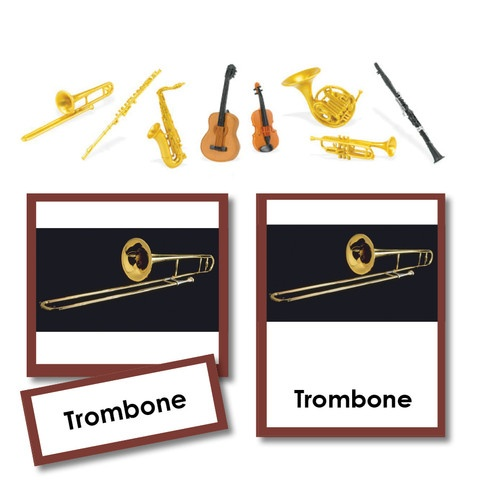 "Discover musical instruments with these large 3-part Cards and matching objects. This Montessori Material has our beautiful nomeclature cards with realistic matching replicas (replicas are up to 3"").:"
