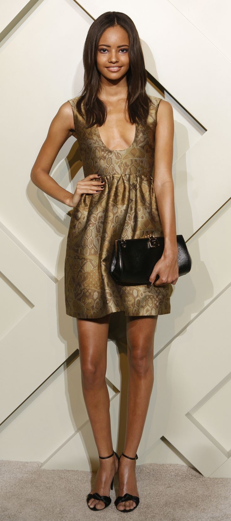 British model Malaika Firth wearing a Burberry dress to attend Thursday's Burberry celebration in Shanghai