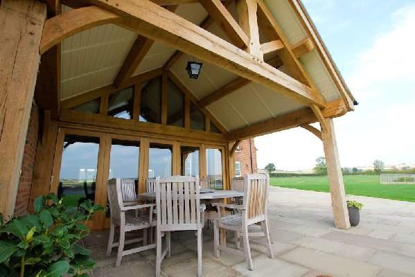 Oak frame extension outdoor extension garden room for Outdoor room extensions