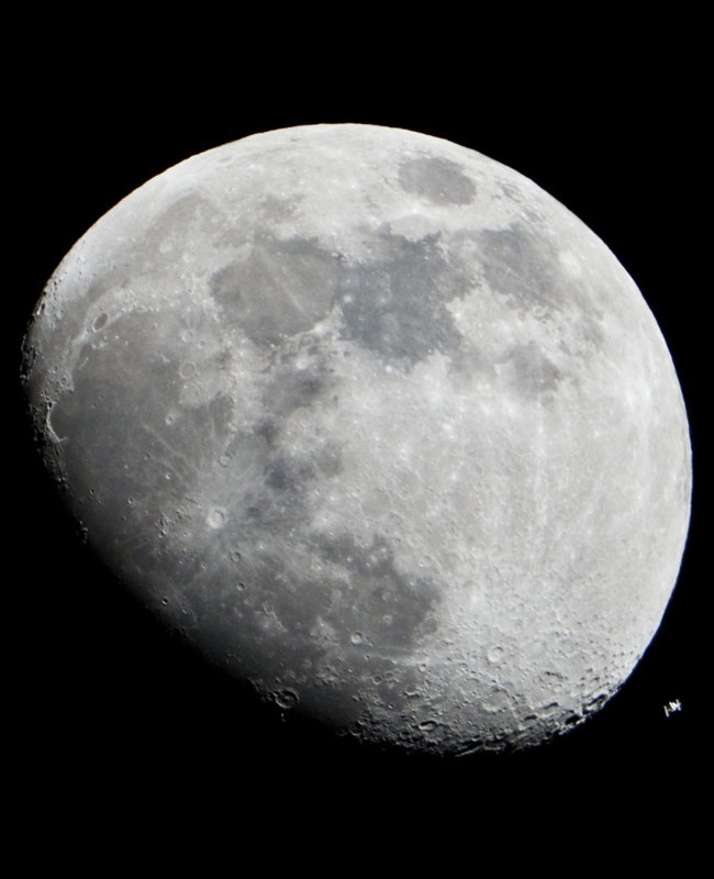 NASA photographer, Lauren Harnett was able to capture this amazing shot of the International Space Station passing the Moon on an ordinary digital camera